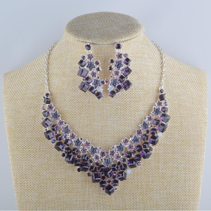 Luxury crystal necklace and earrings pageant set in purple, blue, green, brown and more.