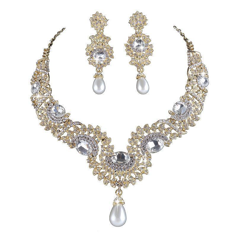 Luxury pearl and crystal necklace and earrings pageant set in gold/silver.