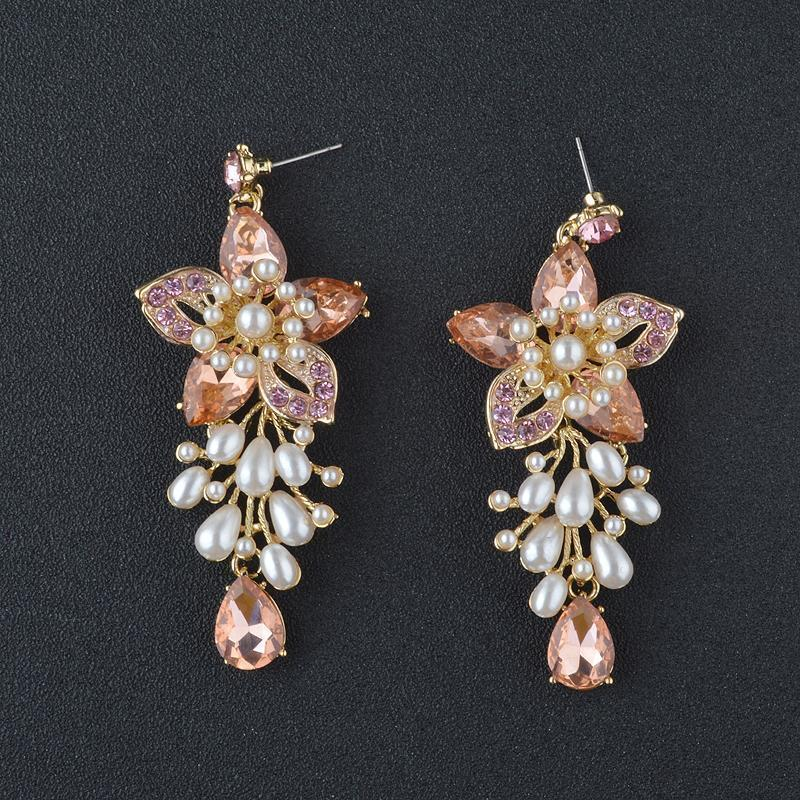 Floral pearl and rhinestone pageant earrings in rose gold.