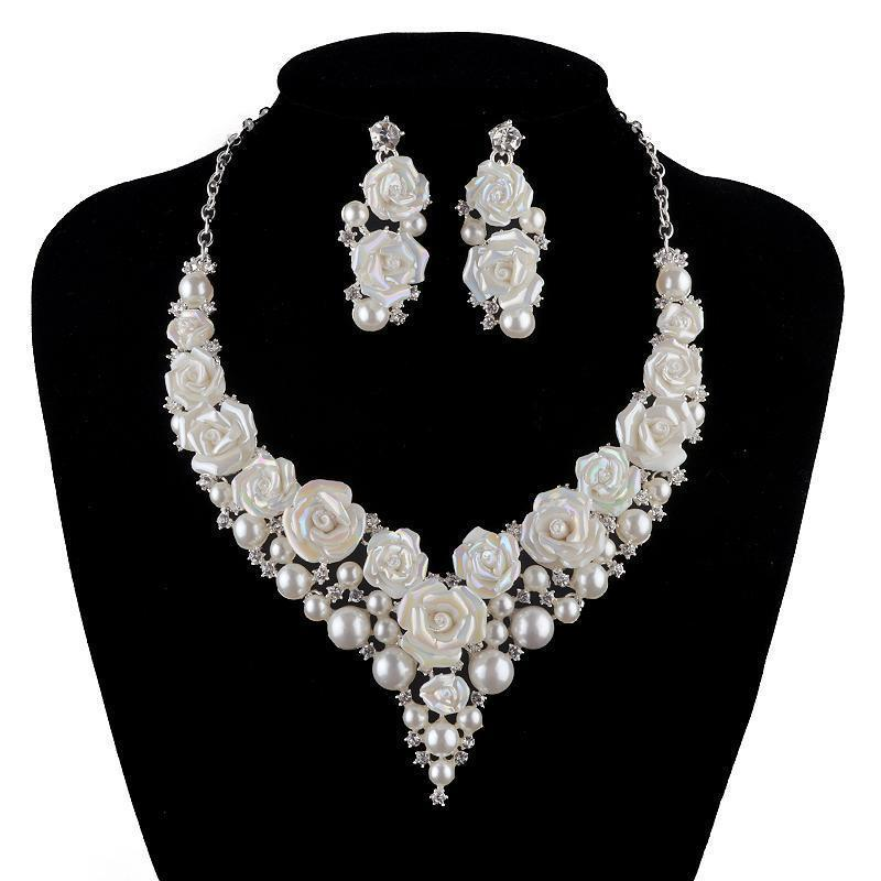 Luxury pearl and floral necklace and earrings pageant set.