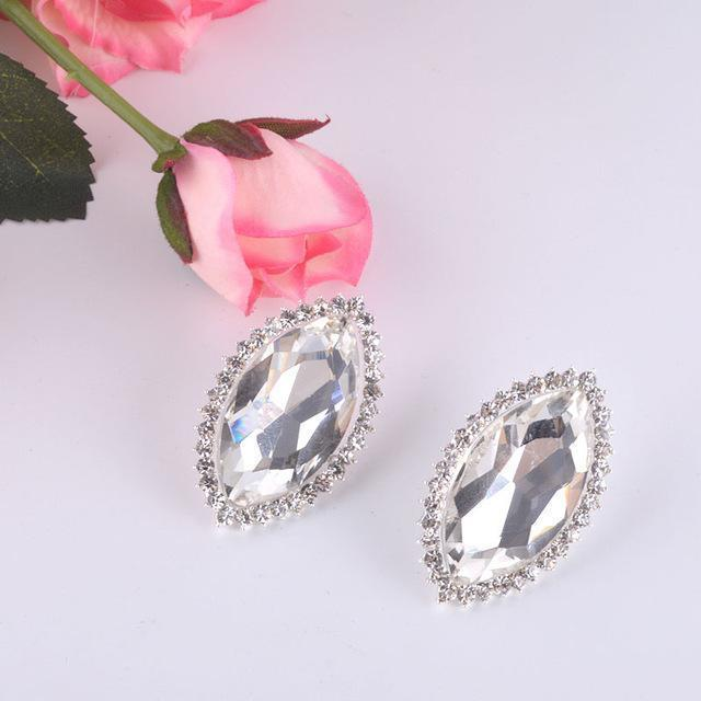 Luxury stud pageant and prom earrings in blue and silver.