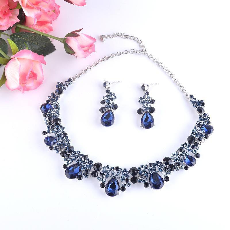 Luxury crystal rhinestone necklace and earrings pageant and prom set in blue, champagne, silver and more.