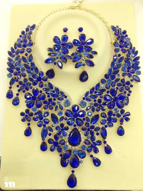 Luxury crystal floral necklace and earrings pageant set in multi, blue, champagne, silver and more.