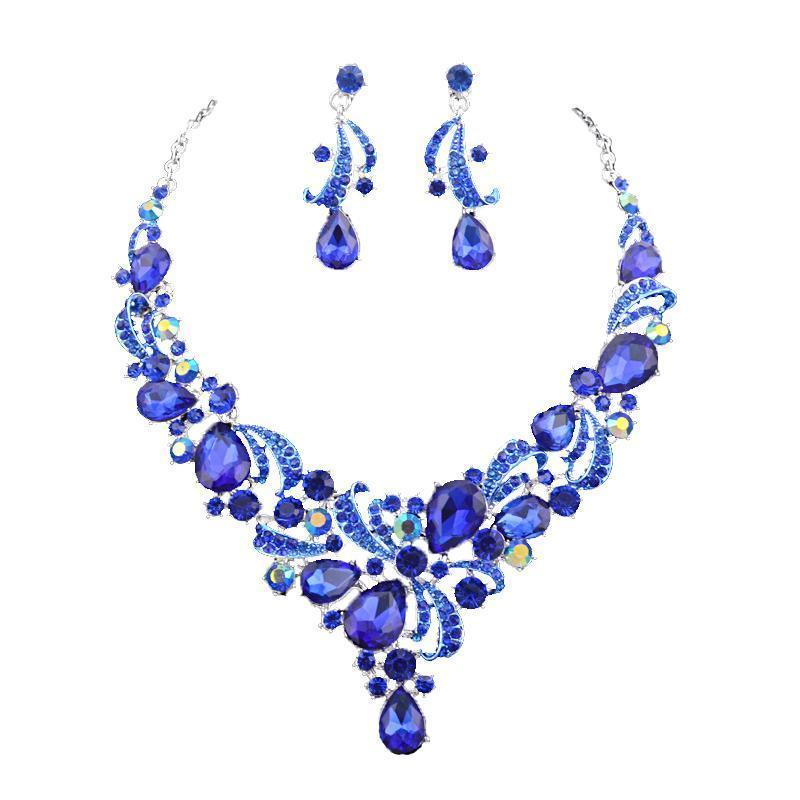 Luxury crystal necklace and earrings pageant set in royal blue.