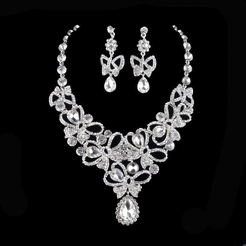 Luxury silver rhinestone crystal necklace and earrings pageant set.