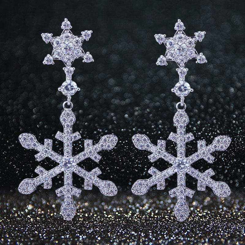 Snowflake cubic zirconia earrings in silver. - jovani-dress