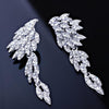 Wing shaped pageant earrings in black and silver. - jovani-dress
