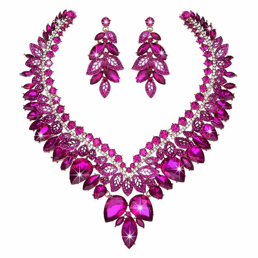 Luxury crystal necklace and earrings pageant set in pink.
