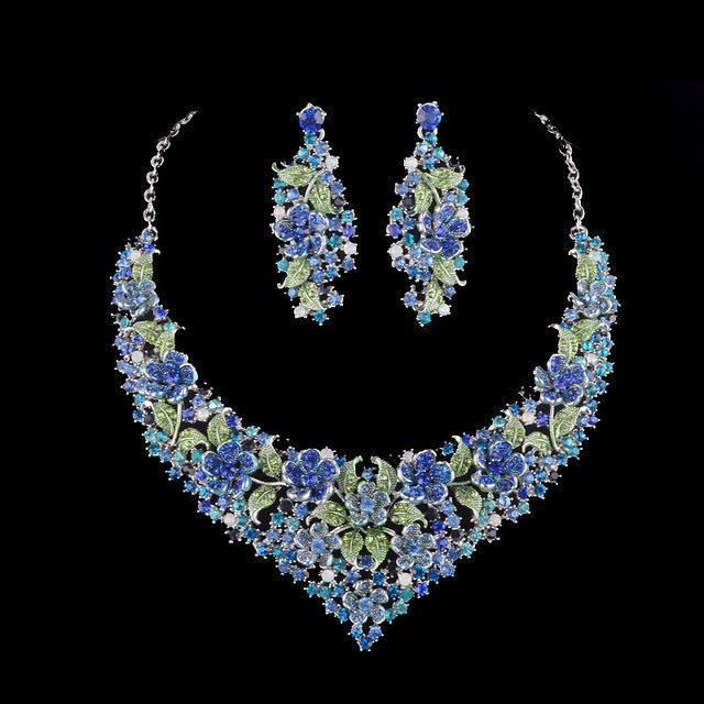 Luxury crystal necklace and earrings pageant set in green, purple and blue.