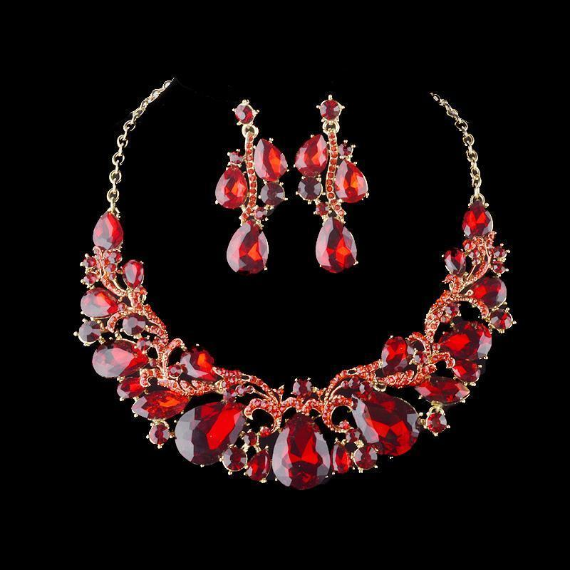 Luxury rhinestone crystal necklace and earrings pageant set in red.