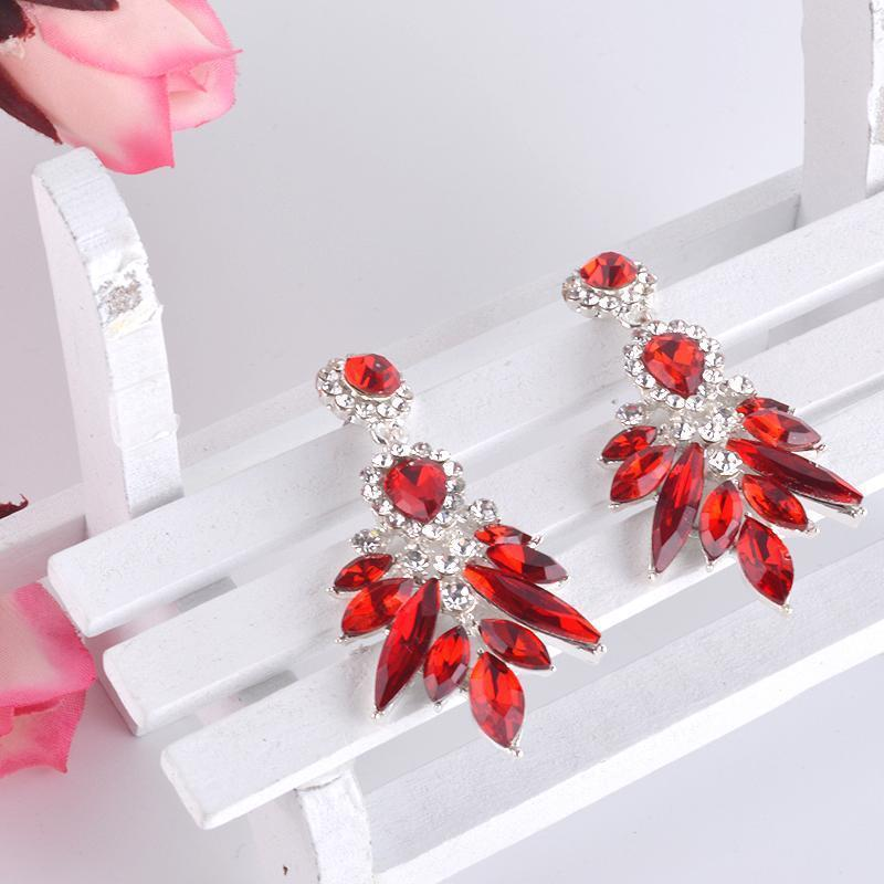 Long red rhinestone pageant earrings.