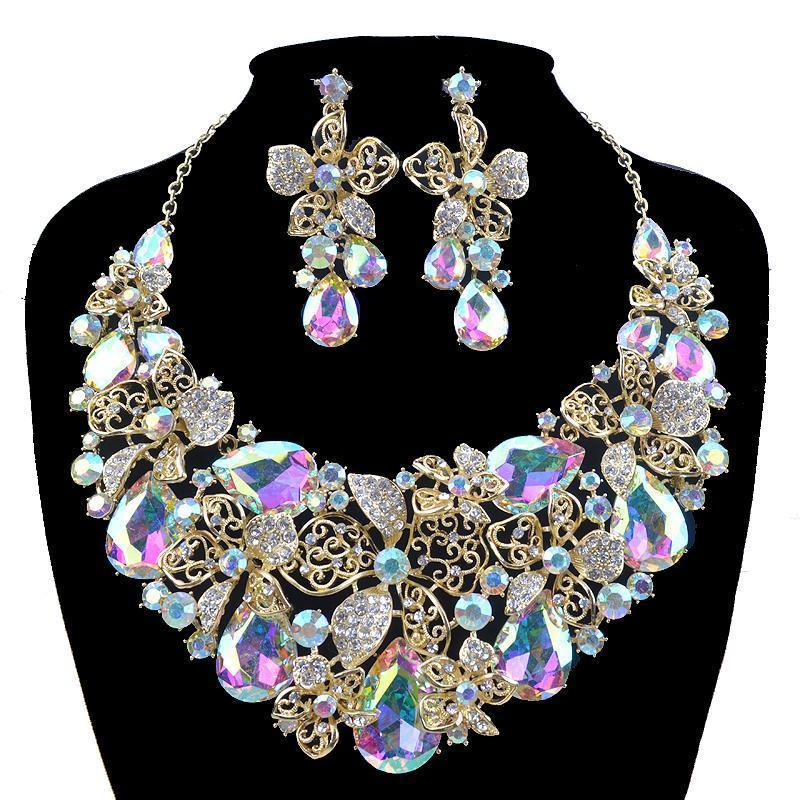 Luxury rhinestone AB crystal necklace and earrings pageant set in gold.