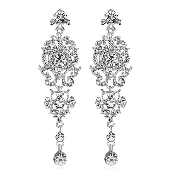 Long silver crystal pageant earrings.