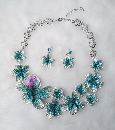 Luxury floral crystal necklace and earrings pageant set in red, blue, multi and more.