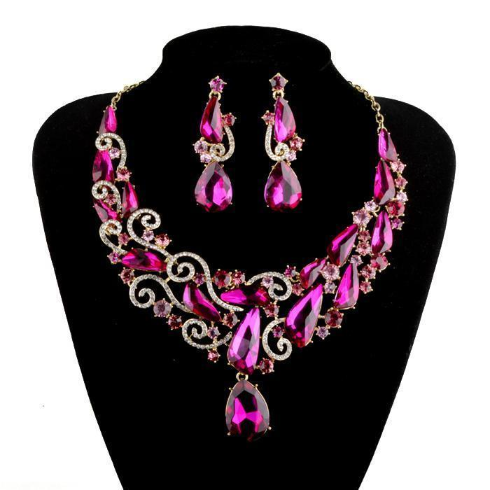 Luxury crystal necklace and earrings pageant set in fuchsia and red.