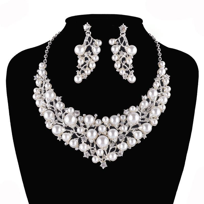 Luxury pearl and crystal necklace and earrings pageant set in silver.