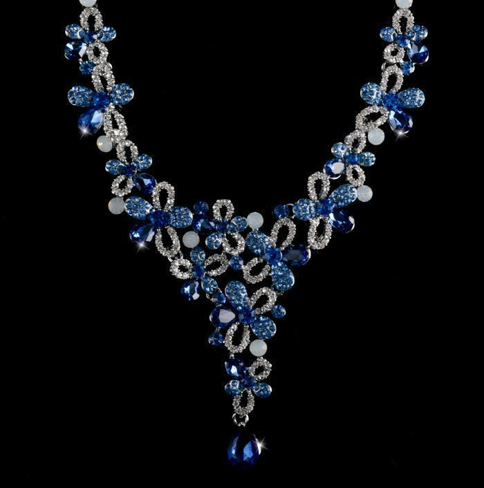 Luxury crystal necklace and earrings pageant set in blue, silver, black, pink, red and more.
