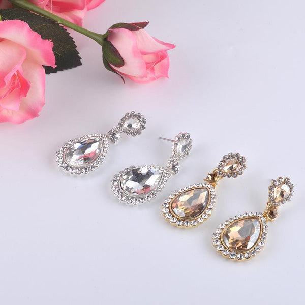 Best seller pageant and prom earrings in silver and champagne.