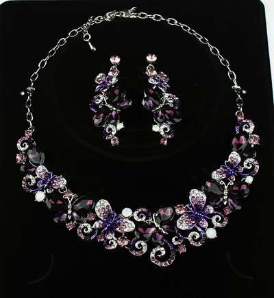 Luxury rhinestone crystal necklace and earrings pageant and prom set in multi, purple, pink, blue and red.
