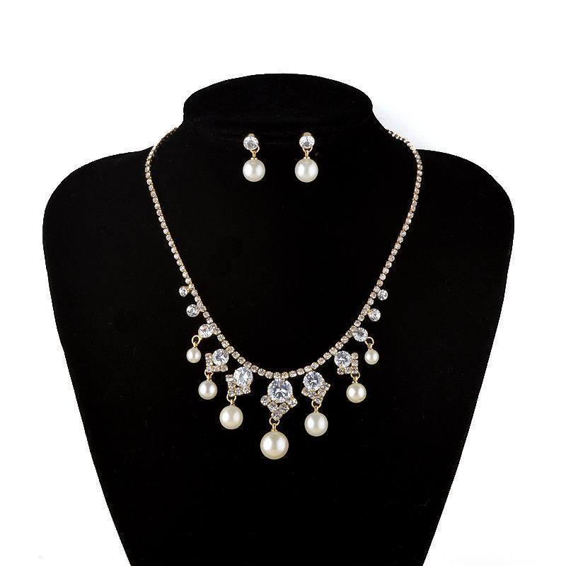 Luxury crystal and pearl necklace and earrings pageant and prom set in silver.