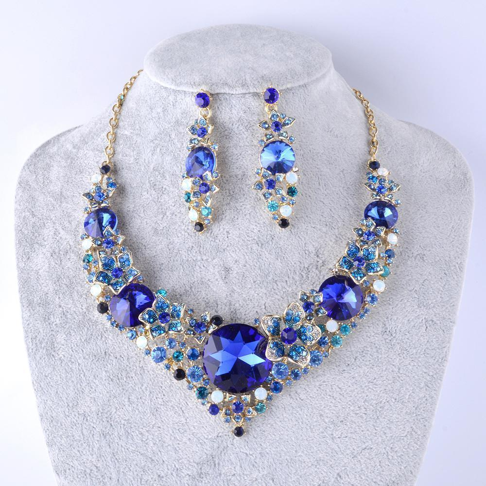 Luxury crystal necklace and earrings pageant set in blue and red.