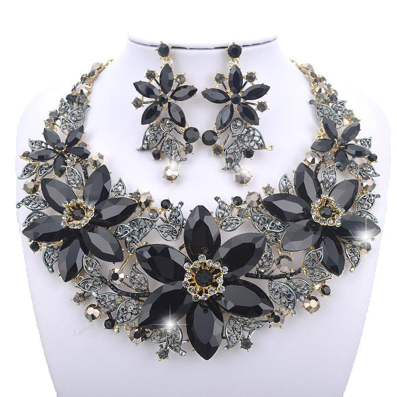 Luxury crystal floral necklace and earrings pageant set in black.