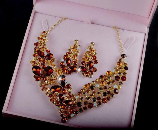 Luxury crystal necklace and earrings pageant set in black, purple, red and more.