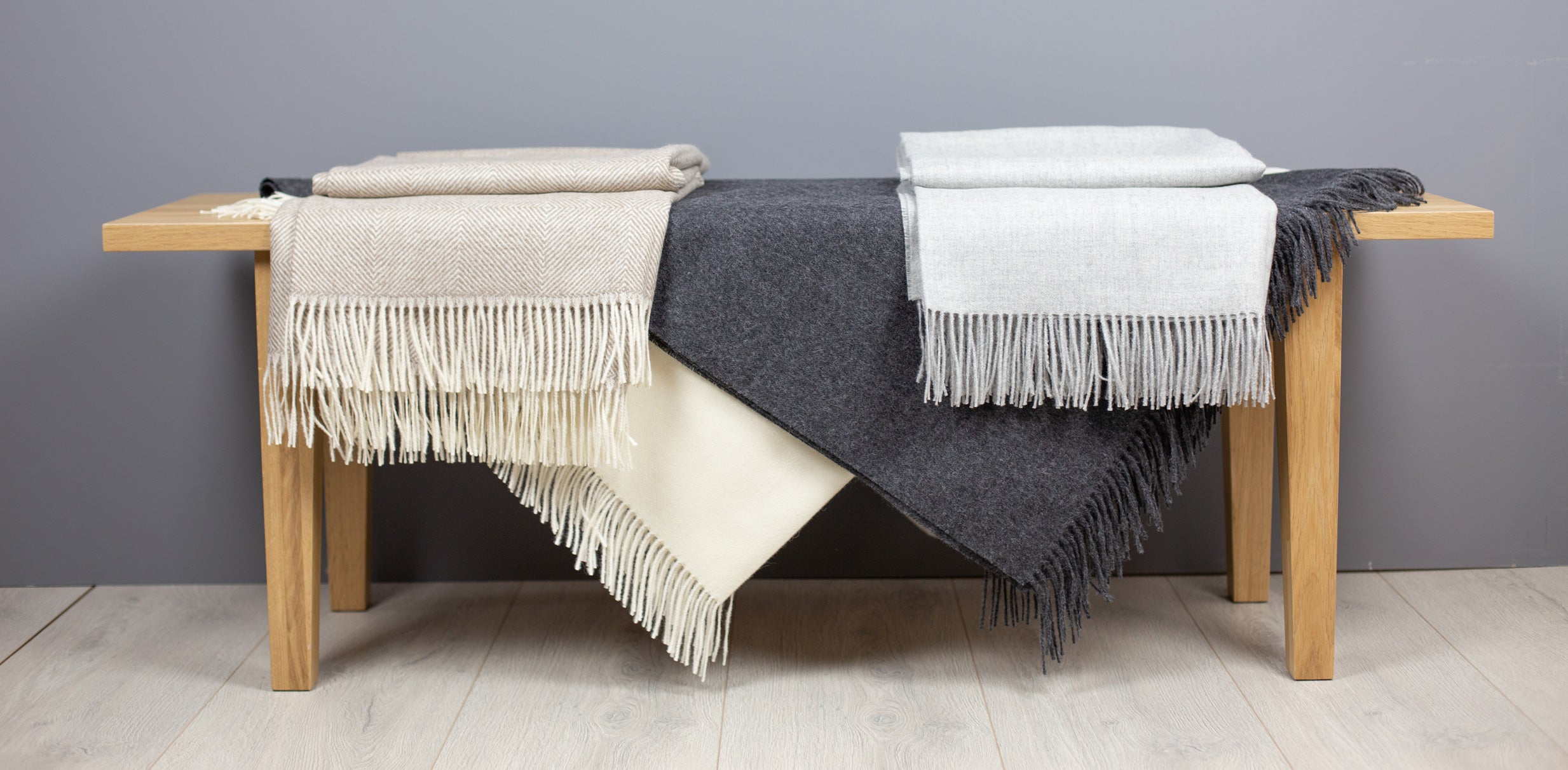 Alpaca wool throws on bench | scooms