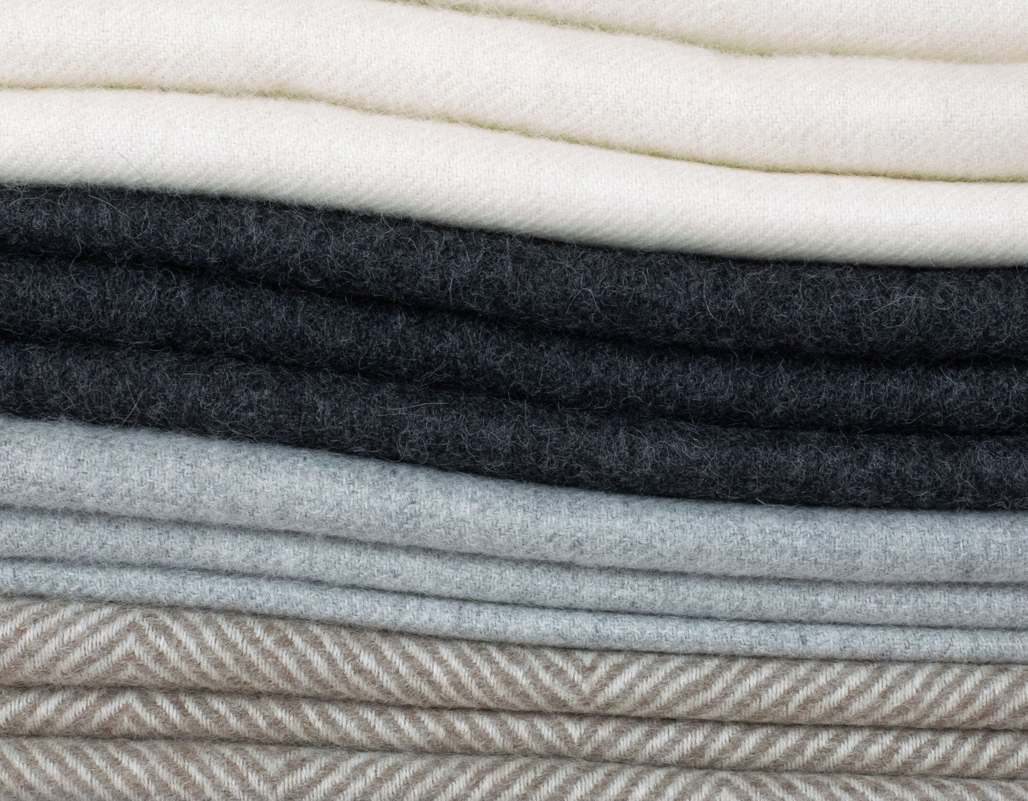 Alpaca wool throws stack | scooms