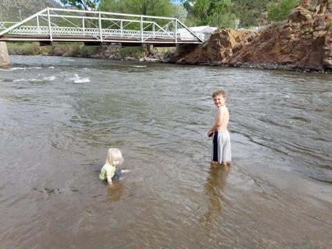 Granddaughter and grandson playing in the Arkansas River at Texas Creek