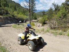 Just old enough to ride the Quad at Texas Creek