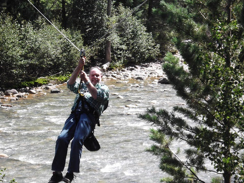 My Pa zip-lining across the river