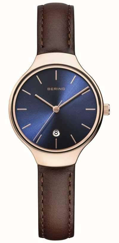 Ladies Bering watch with a blue dial and brown strap and rose gold case
