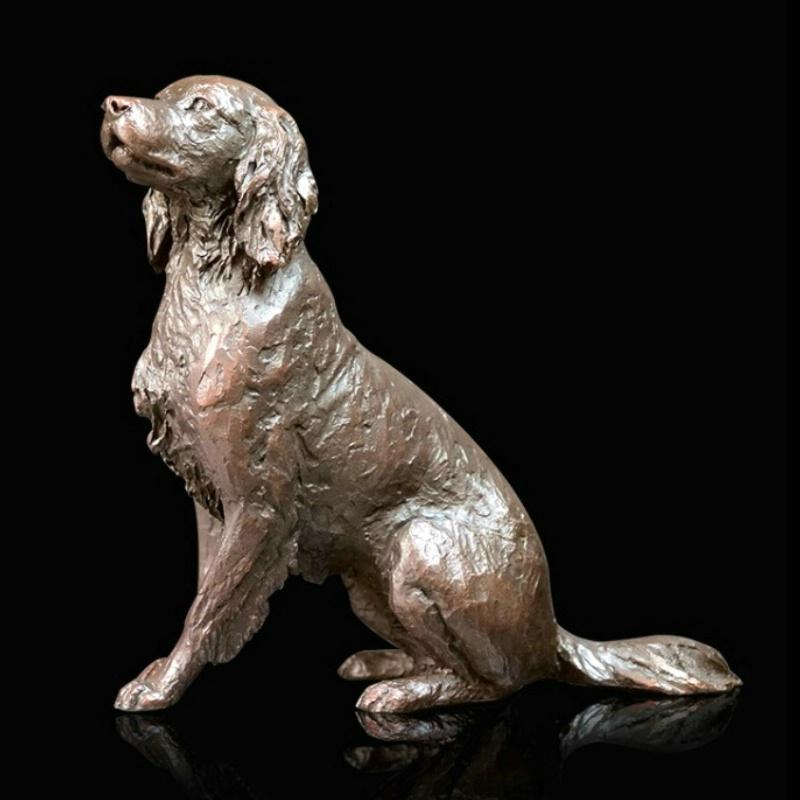 Bronze sculpture of a Springer Spaniel sitting and looking up at his owner