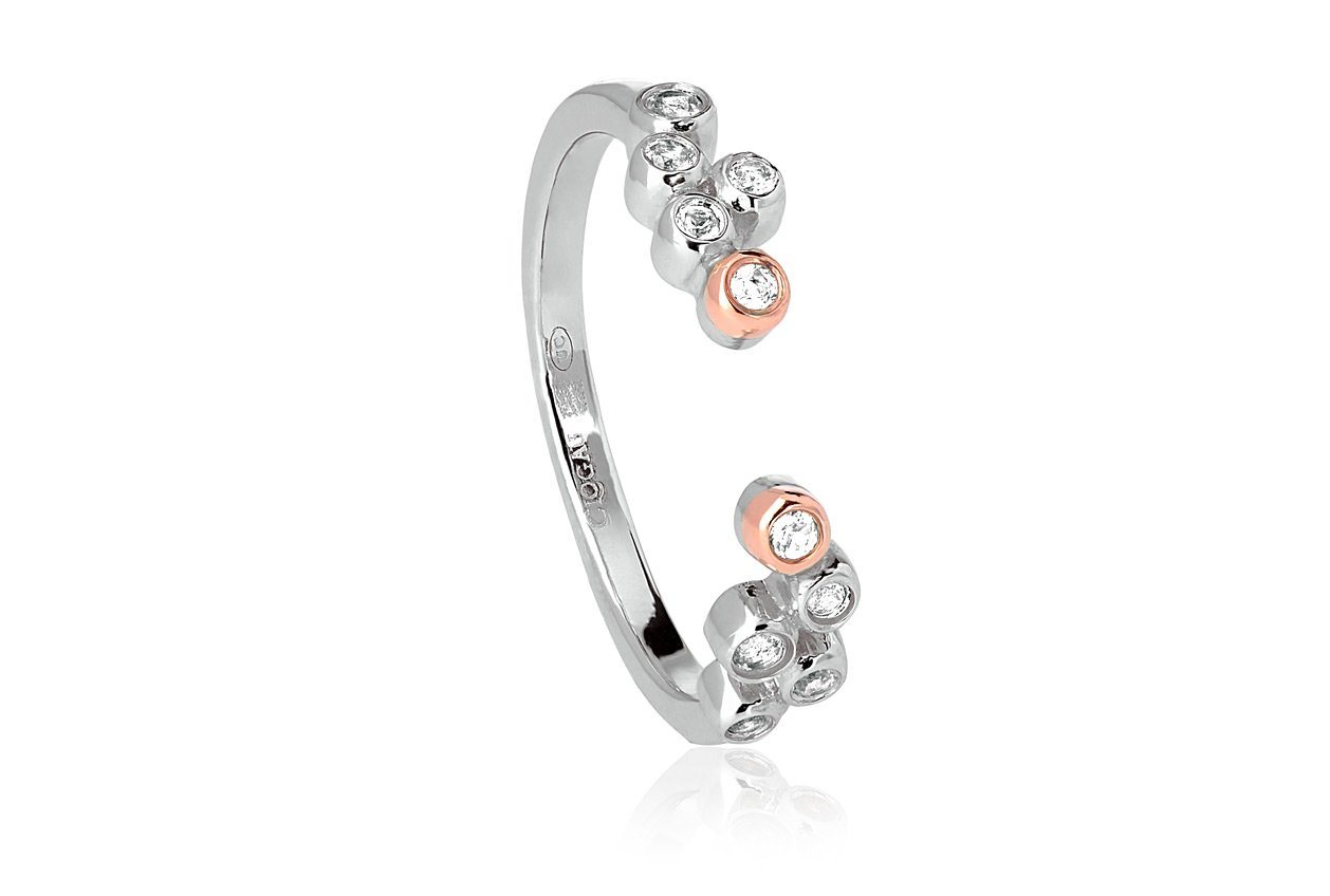 Silver ring with rose gold and topaz stones which is open at the front