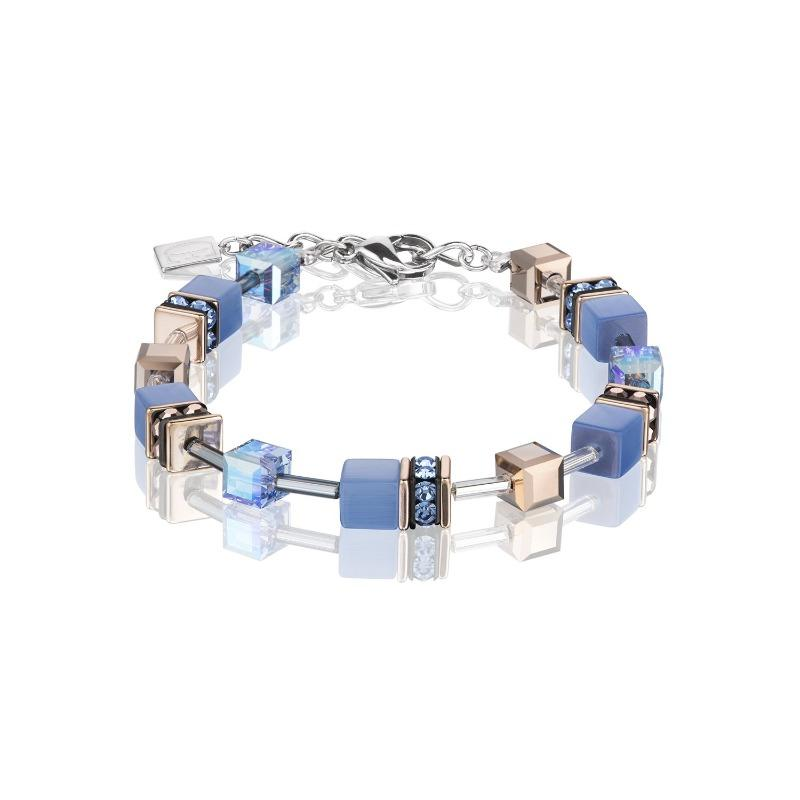 Bracelet in rose gold colour with cubes of blue and Swarovski crystals.