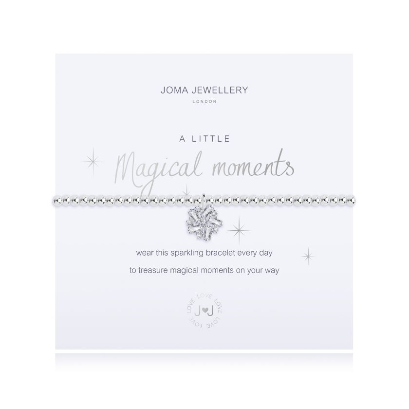 "Silver-plated beaded stretchy bracelet with a sparkly pin-wheel dangle charm hanging from the centre, presented on a meaning card reading ""A Little Magical Moments"" bracelet"
