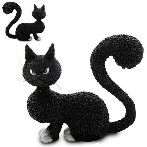 A comical black and white figurine of a cat looking very cross with bushy tail