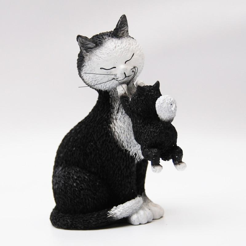 A figurine of a mother cat and her kitten playing