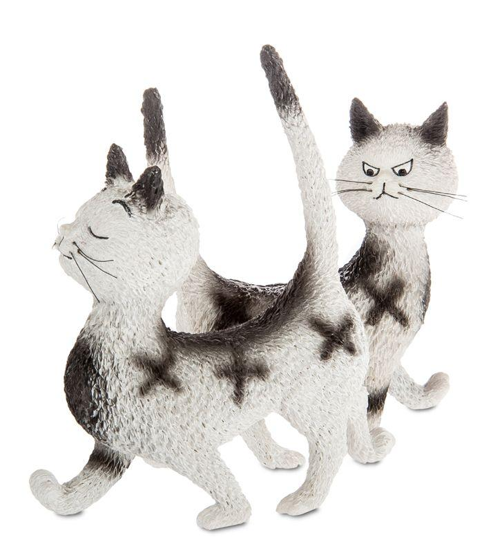 A comical ornament of two cats with identical markings