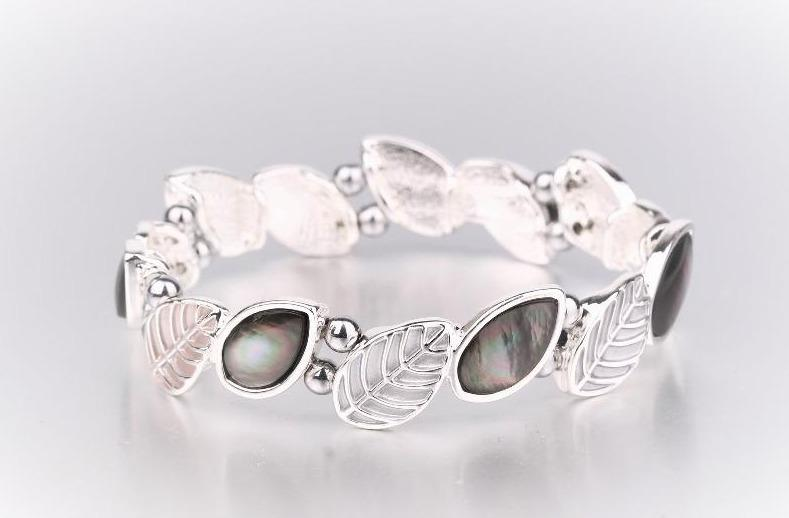 Magnetic hematite bracelet in a leaves design, with alternate openwork leaf and mother of pearl leaf pattern