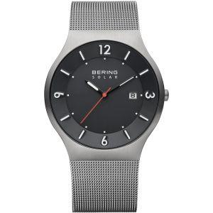 Berings gents watch which is solar powered with grey steel case and mesh strap with black dial