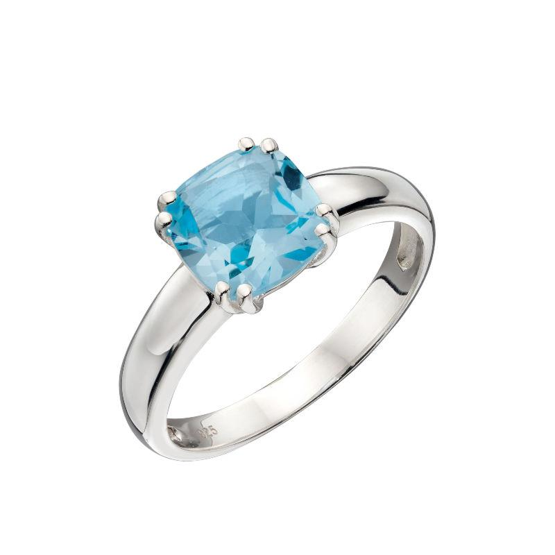 Silver ring with cushion cut blue topaz