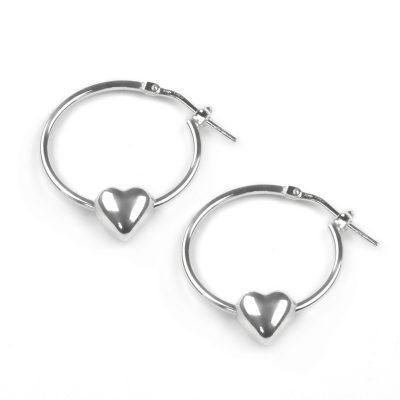 Silver Hoop earrings with lever latch fitting and a polished heart charm which the hoop goes through.