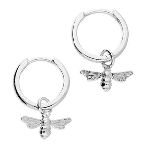 Silver small hoop earrings with a bee charm dangle from each hoop.