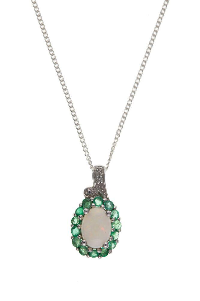 silver pendant with central oval opal surrounded by emeralds and with diamonds at the top