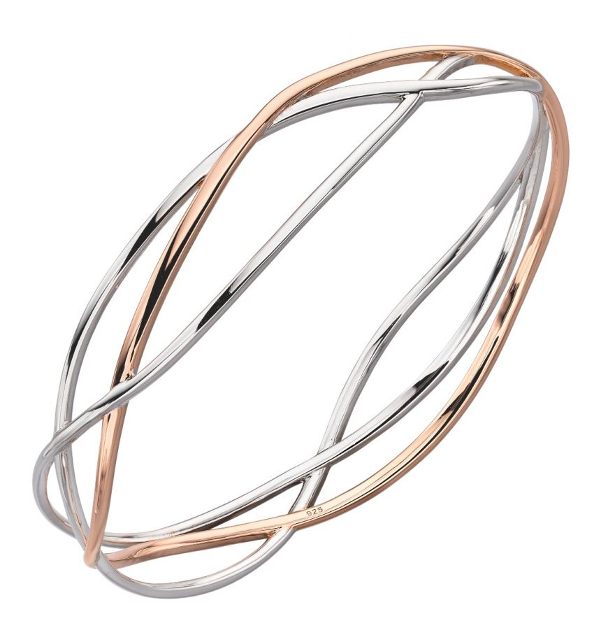 A silver and rose gold oval bangle in three strands in an openwork design