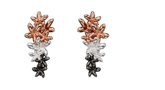 A pair of cluster flower earrings in three coloured silver- silver, rose gold plated and oxidised.