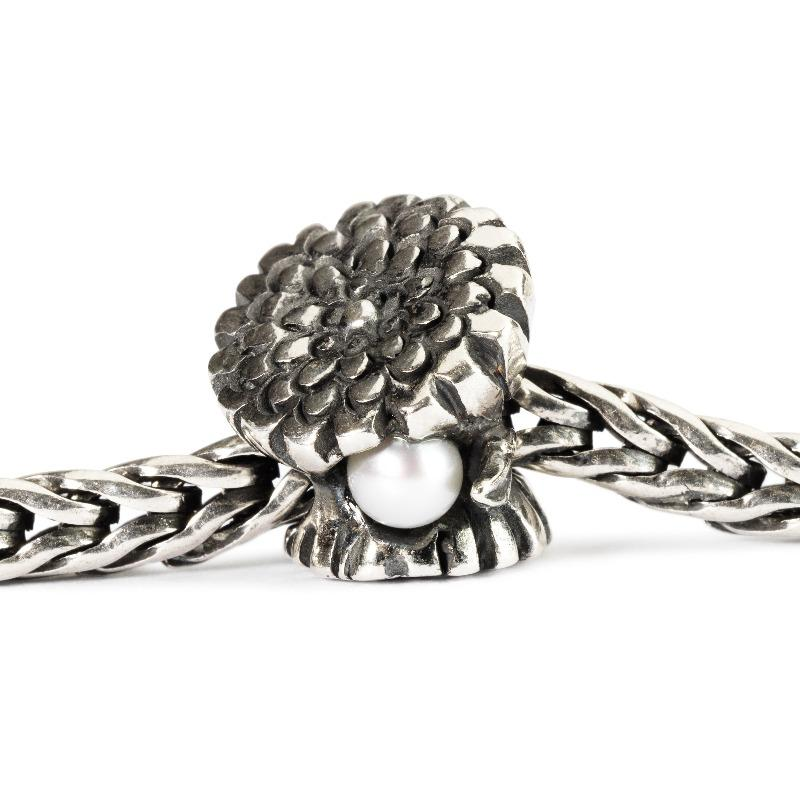 Silver charm bead featuring a calendual flower and pearl for the month of October to fit a Trollbeads bracelet