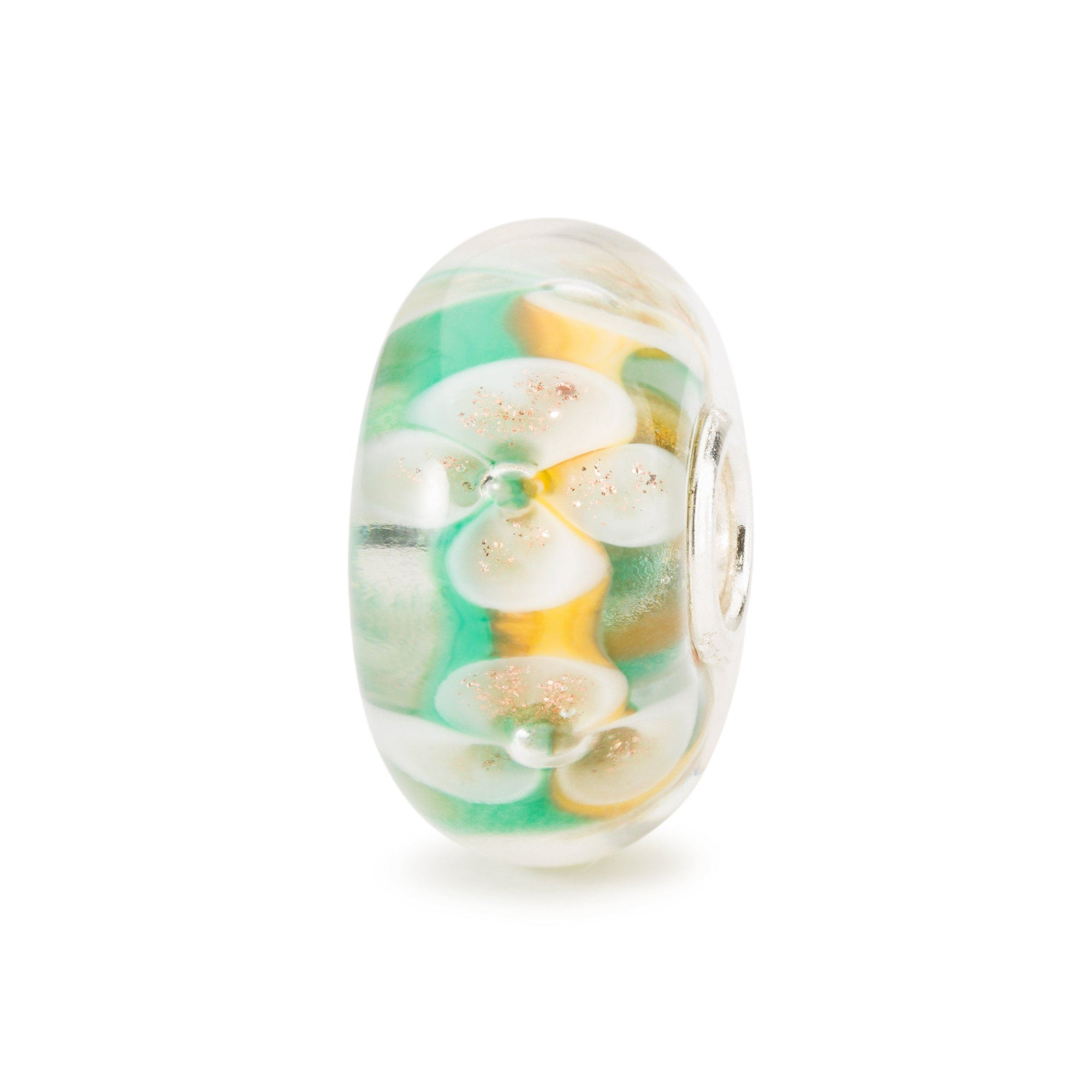 Glass  charm for for modern charm bracelet with white flowers over a background of green and yellow, for a Trollbeads bracelet.